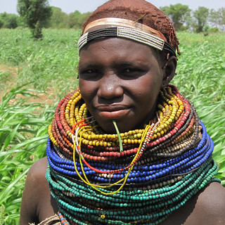 Nyangatom woman tending sorghum fields, Ethiopia
