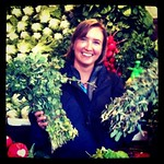 Audrey sells fresh sage & thyme at market in Amman, Jordan