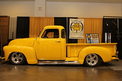 antique car(0.0), automobile(1.0), automotive exterior(1.0), pickup truck(1.0), yellow(1.0), wheel(1.0), vehicle(1.0), truck(1.0), automotive design(1.0), auto show(1.0), chevrolet advance design(1.0), land vehicle(1.0), motor vehicle(1.0), classic(1.0),