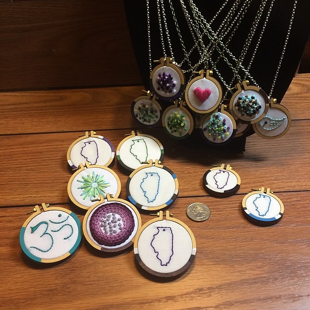 Brooches on the left, necklaces on the right (including 2 of Illinois that don't yet have chains attached). The quarter is for scale. I will have these - and more! - at Urban Farmgirl's Main Street Market at Midway Village in Rockford, IL Saturday, May 10