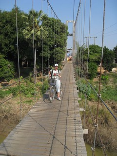 biking on suspension bridge