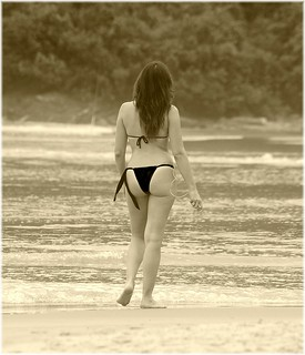 Lonely girl walking down the beach ( sepia ) Brasil