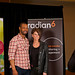Conference attendees have their photo taken with Isaiah Mustafa