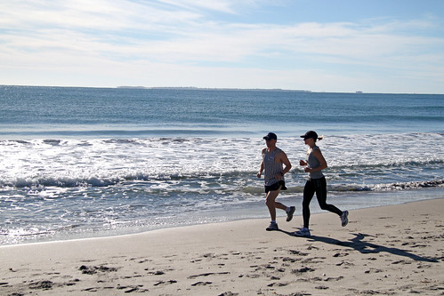 Ian and Susan jogging on Maunganui beach 1