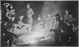 Around the camp-fire, men of Company A, 16th Infantry, San Geronimo, Mexico, May 27th, 1916. This photo was obtained by flashlight powder., 1922 - 1922