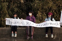 OSHIMA ISLAND, Japan (April 7, 2011) Children hold a banner with their mother, thanking Marines and Sailors of the 31st Marine Expeditionary Unit for their work. The Marines and Sailors spent about six days cleaning up debris on parts of the island, during Operation Field Day. (Marine Corps photo by Lance Cpl. Garry J. Welch)