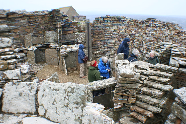 Tour group at Broch of Gurness, (Iron-Age), Orkney, Scotland