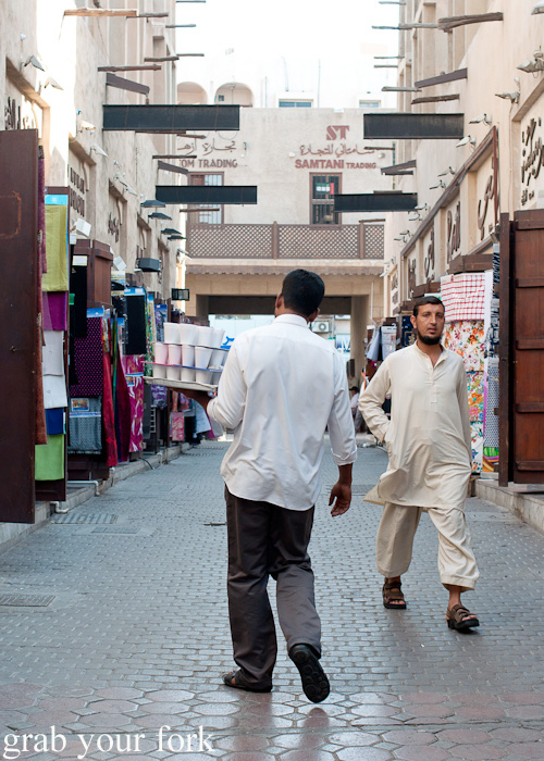 Delivering tea in the Textile Souk in Meena Bazaar, Dubai