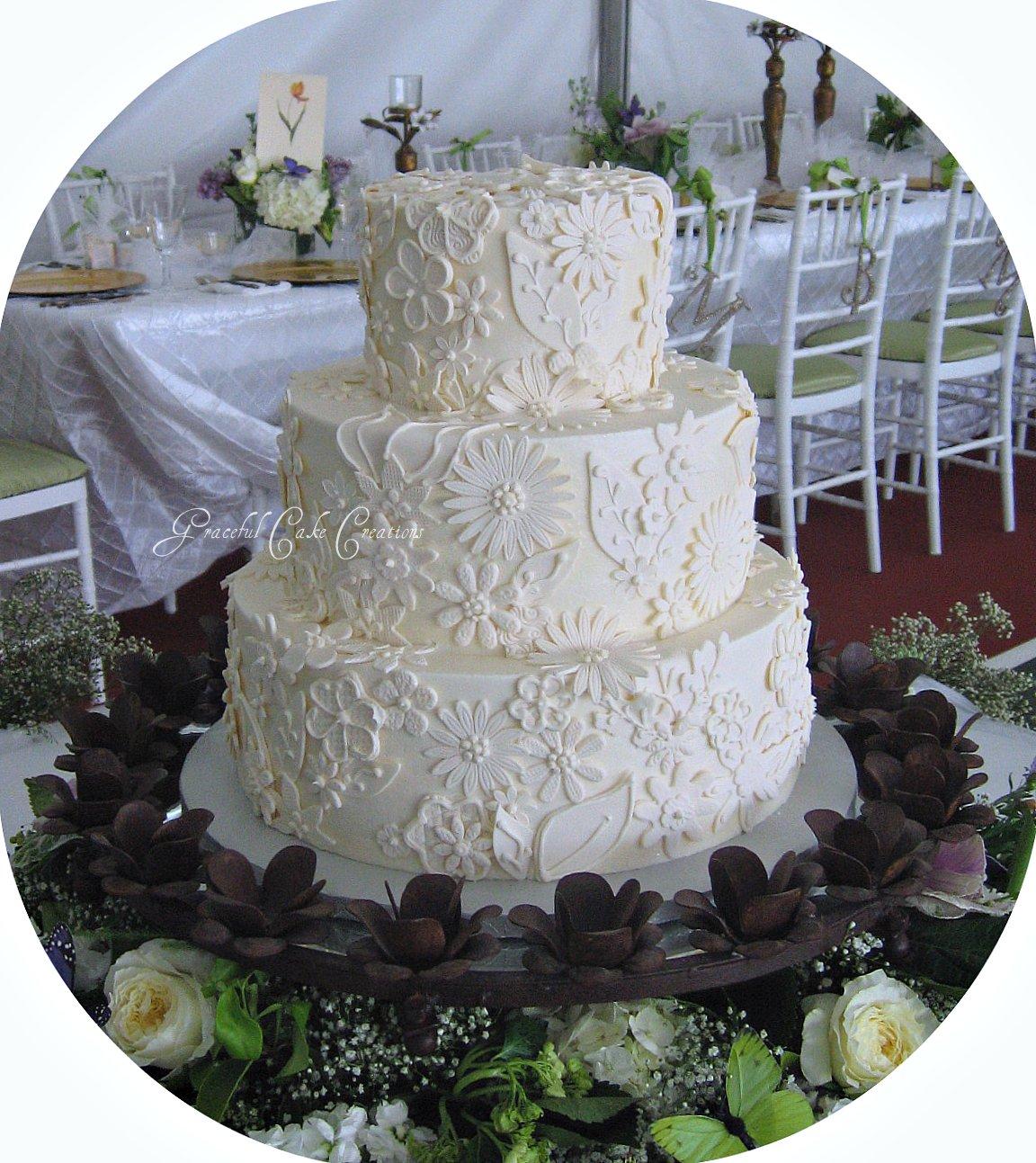 Elegant Ivory Wedding Cake with Lace Applique