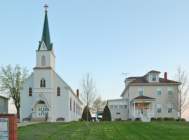 Immaculate Conception Roman Catholic Church, in Augusta, Missouri, USA - exterior at sunset with rectory