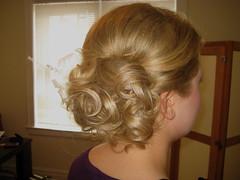 chin(0.0), face(0.0), ringlet(0.0), french braid(0.0), brown hair(0.0), forehead(0.0), hairstyle(1.0), chignon(1.0), bun(1.0), hair(1.0), blond(1.0), hair coloring(1.0),