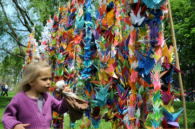Origami cranes folded on the South Meadow will be sent to Japan as a gesture of support and unity. Photo by Mike Ratliff.