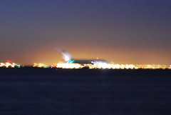 A380 silhouette in the lights of the Oakland Collusuem.