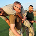 Sailors take part in the Marine Corps combat fitness test.