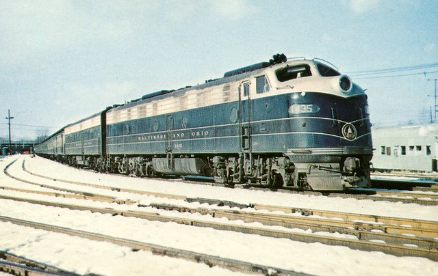 B&O0003 B&O train No. 57 stands in the yard after a run, EMD E units 1435 and 2410 provided the Power on this cold third Day in January 1961. (Mac Owen)