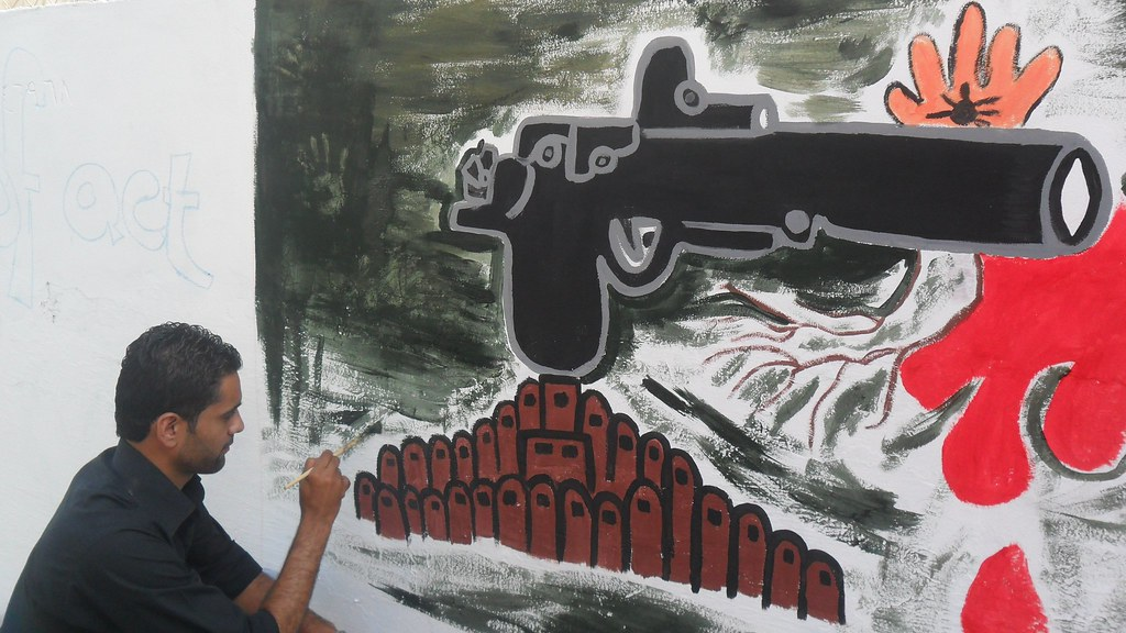 Week of Action Against Gun Violence 2011 - Palestine - Youth drawing mural in Gaza