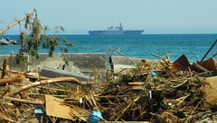 OSHIMA ISLAND, Japan (April 1, 2011) The Japan Maritime Self Defense Force ship JS Hyuga (DDH 181) is anchored off the coast while Marines with the 31st Marine Expeditionary Unit and Sailors with the Essex Amphibious Ready Group are on Oshima Island assisting Japan Self Defense Forces with clearing a harbor and assist with cleaning debris from local schools and government buildings in support of Operation Tomodachi. (U.S. Navy photo by Mass Communication Specialist 2nd Class Eva-Marie Ramsaran)