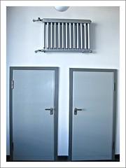 shelf(0.0), furniture(0.0), bathroom cabinet(0.0), metal(1.0), door(1.0),