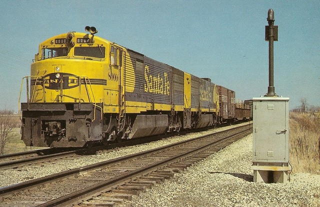 ATSF0006 Westbound U30CG's (with steam generators removed) 8000 and 8002 are west of Galesburg, Ill. The few times the 8000s were run by this time in their lives they were usually buried in the middle of a consist. The crews hated the cabs and the units w