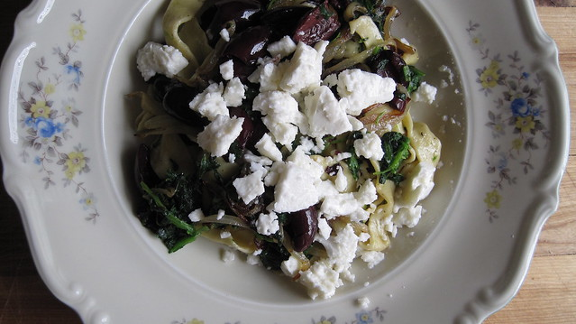 Fresh pasta with olives, spinach, and feta