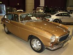 automobile(1.0), automotive exterior(1.0), vehicle(1.0), performance car(1.0), automotive design(1.0), antique car(1.0), volvo p1800(1.0), classic car(1.0), vintage car(1.0), land vehicle(1.0), luxury vehicle(1.0), sports car(1.0),