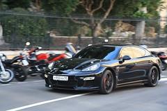 sports car(0.0), automobile(1.0), automotive exterior(1.0), family car(1.0), wheel(1.0), vehicle(1.0), performance car(1.0), automotive design(1.0), porsche(1.0), porsche panamera(1.0), sports sedan(1.0), bumper(1.0), land vehicle(1.0), luxury vehicle(1.0), supercar(1.0),