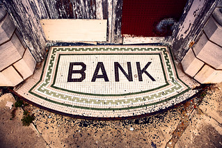 Tile Bank Sign Mat in old rural town in OK oklahoma