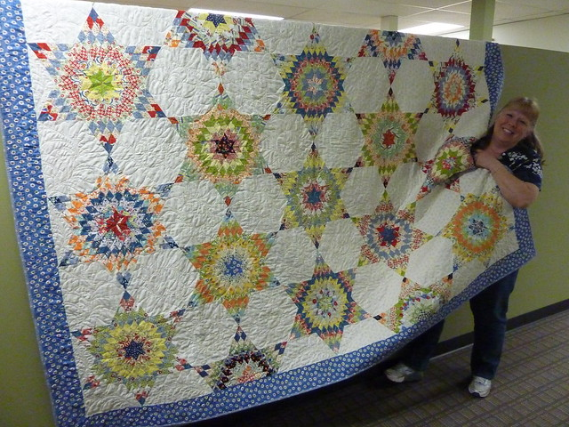 Linda with her anniversary quilt