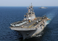 PACIFIC OCEAN (April 6, 2011) The forward-deployed amphibious assault ship USS Essex (LHD 2) steams off the coast of northeastern Japan with the Japan Maritime Self Defense Force Ship JS Hyuga (DDH 181). (U.S. Navy photo by Mass Communication Specialist 2nd Class Mark R. Alvarez/Released)