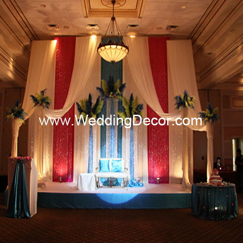 A Brazilian Carnival Masquerade themed wedding reception with a backdrop