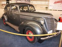 renault juvaquatre(0.0), automobile(1.0), automotive exterior(1.0), 1937 ford(1.0), moskvitch 400-420(1.0), vehicle(1.0), mid-size car(1.0), hot rod(1.0), antique car(1.0), vintage car(1.0), land vehicle(1.0), motor vehicle(1.0),