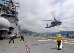 "SASEBO, Japan (June 21, 2011) – An MH-60S Seahawk from Helicopter Sea Control Squadron 25 ""Island Knights"" lands on the flight deck of the amphibious assault ship USS Essex (LHD 2) in preparations for getting underway. (U.S. Navy photo by Mass Communication Specialist 3rd Class Adam M. Bennett/Released)"
