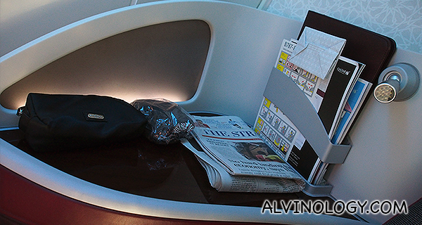 Well-designed Business Class seats, with ample space to stow all sorts of stuff, including a side desk for me to place my newspapers, Kindle and vanity kit