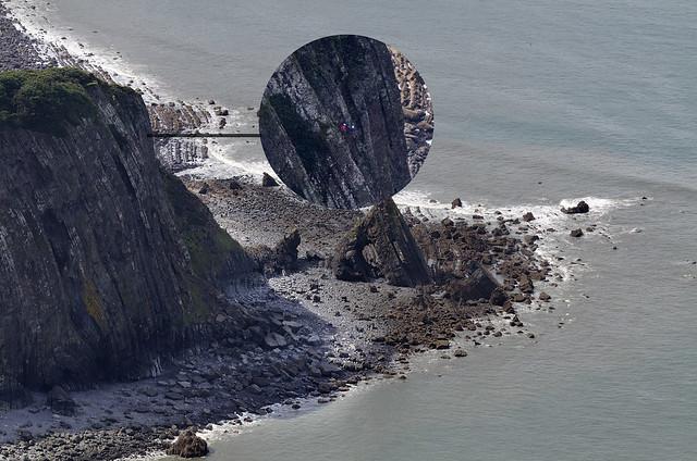 Looks terrifying. Climbers near Blackchurch Rock in North Devon - aerial image