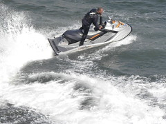 sailing(0.0), wakeboarding(0.0), rapid(0.0), motorsport(0.0), inflatable boat(0.0), boat(0.0), vehicle(1.0), sports(1.0), sea(1.0), boating(1.0), wind wave(1.0), motorboat(1.0), extreme sport(1.0), wave(1.0), water sport(1.0), jet ski(1.0), personal water craft(1.0), watercraft(1.0),