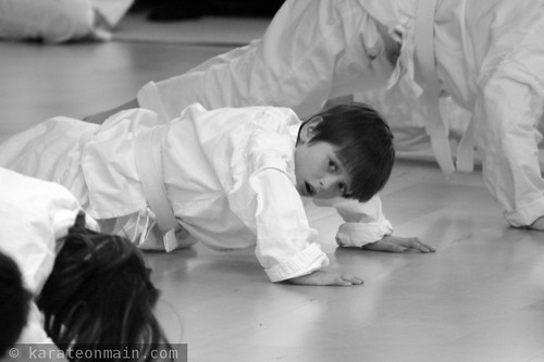 nick doing push ups during his karate exam