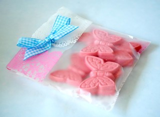 Hand-made pink chocolate butterflies packaged up