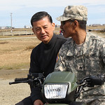 Secretary Shinseki in Alaska on a motorcycle with a soldier
