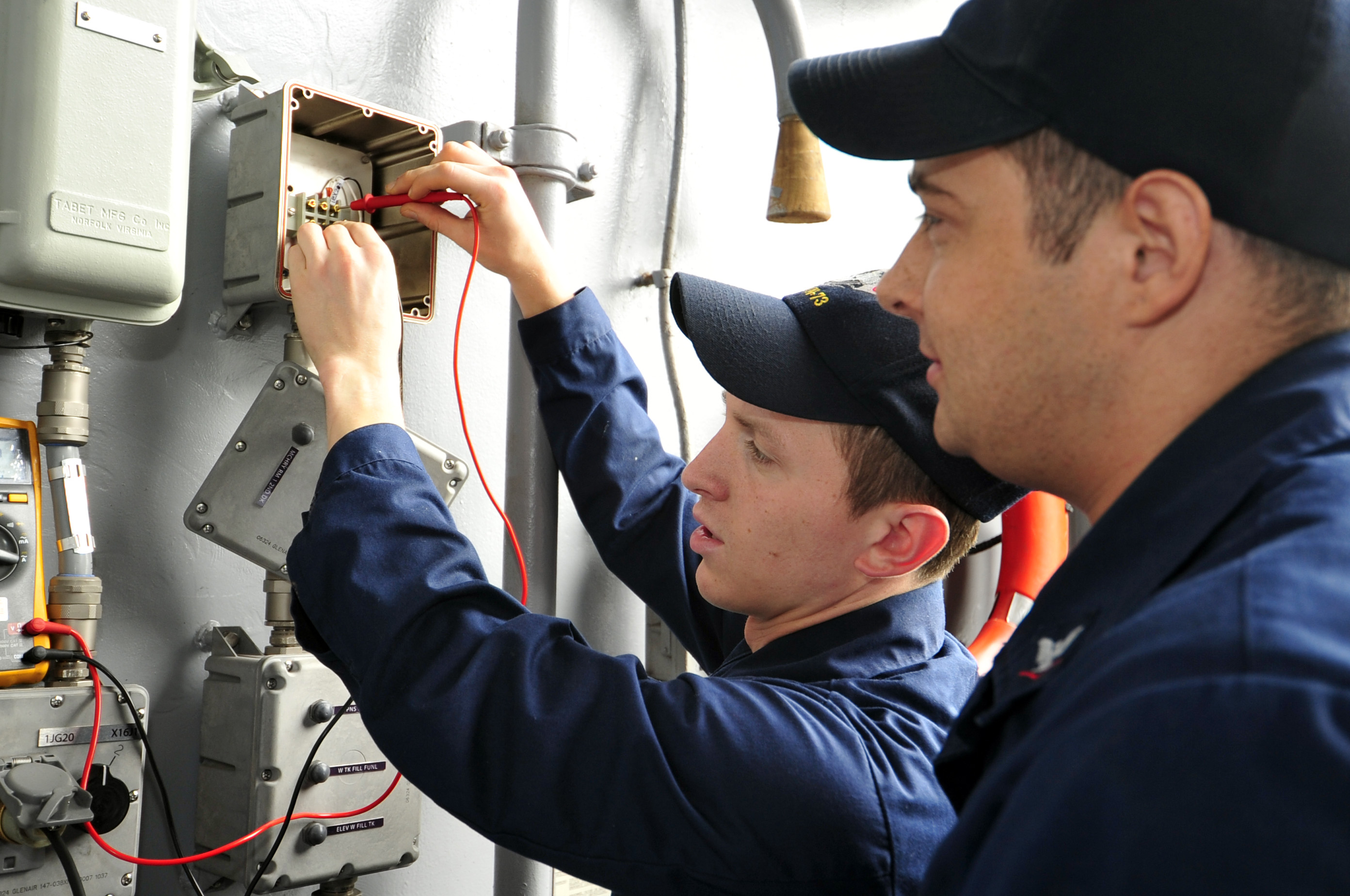 Sailors Check For Voltage On An Aircraft Carrier Elevator