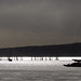 Yachts at anchor under winter skies by Mike Brebner