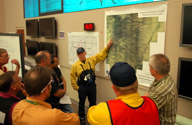 Emergency Operations Center, Los Alamos National Laboratory.  Los Alamos County Fire Chief Doug Tucker at the map.  Photo by Jeff Berger.