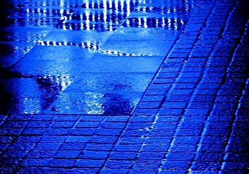 Neon-drenched sidewalk