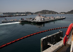 YOKOSUKA, Japan (March 25, 2011) Barge YOGN-115, carrying 1.04 million litres (275,000 gallons) of fresh water, departs Commander, Fleet Activities Yokosuka (CFAY) to support cooling efforts at the Fukushima Daiichi nuclear power plant. CFAY port operations cleaned and filled two barges, totaling nearly 1.89 million litres (500,000 gallons) of fresh water. (U.S. Navy photo by Mass Communication Specialist 3rd Class Mikey Mulcare)