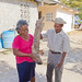 Lorencio and Ancelma showing of a giant yam by Smaller World Tours