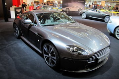 aston martin db9(0.0), automobile(1.0), aston martin dbs v12(1.0), wheel(1.0), vehicle(1.0), aston martin v8 vantage (2005)(1.0), aston martin dbs(1.0), aston martin vantage(1.0), performance car(1.0), automotive design(1.0), auto show(1.0), land vehicle(1.0), luxury vehicle(1.0), coupã©(1.0), supercar(1.0), sports car(1.0),