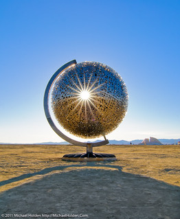 """The spinning concentric metal spheres of Michael Christian's """"Home""""  at Burning Man 2010"""