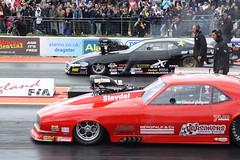 auto show(0.0), motorcycle racing(0.0), race car(1.0), auto racing(1.0), automobile(1.0), racing(1.0), sport venue(1.0), vehicle(1.0), stock car racing(1.0), sports(1.0), custom car(1.0), performance car(1.0), automotive design(1.0), motorsport(1.0), drag racing(1.0), race track(1.0), land vehicle(1.0), muscle car(1.0), sports car(1.0),