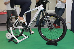 racing bicycle(0.0), wheelchair racing(0.0), endurance sports(1.0), road bicycle(1.0), wheel(1.0), vehicle(1.0), sports(1.0), sports equipment(1.0), bicycle frame(1.0), bicycle(1.0),