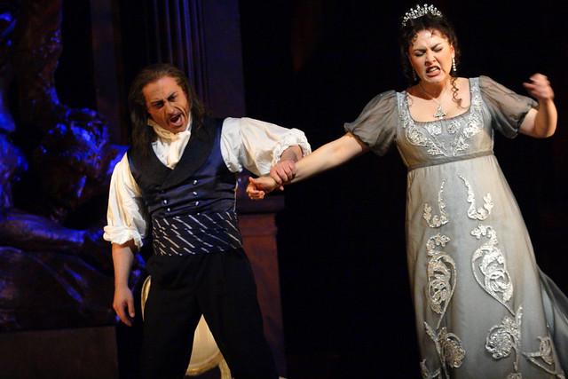 Marco Vratogna as Baron Scarpia and Oksana Dyka as Floria Tosca in Tosca © ROH / Catherine Ashmore 2014