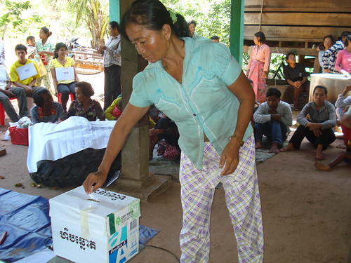 16 A villager casts her vote for the community-protected area committee